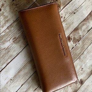 Michael Kors three quarter zip wallet.